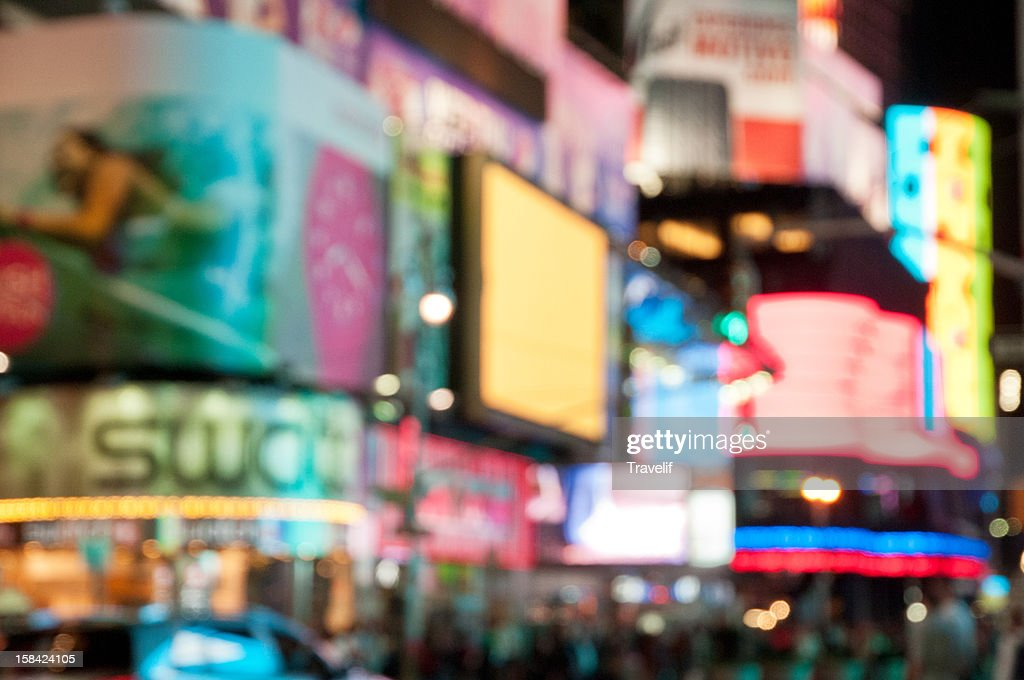 Defocused neon lights of Broadway in Times Square : Stock Photo
