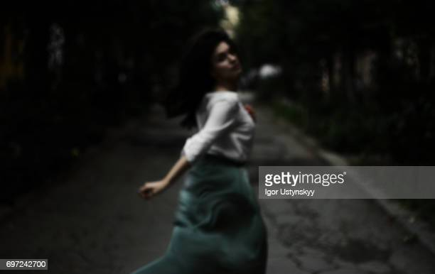Defocused photo of woman running on the street