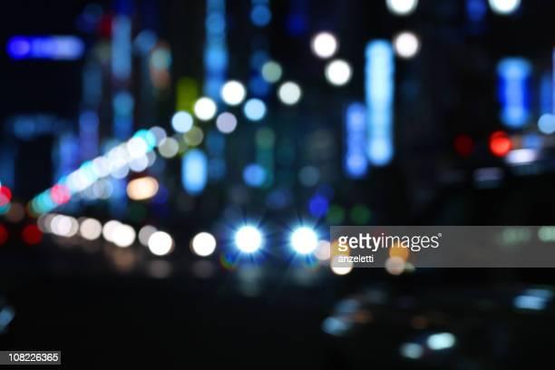 Sans mise au point Street et de lumières en soirée à Tokyo