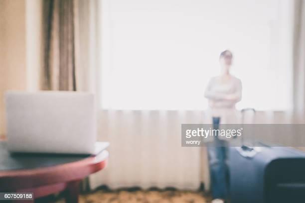 Defocused view of businesswoman work at hotel room