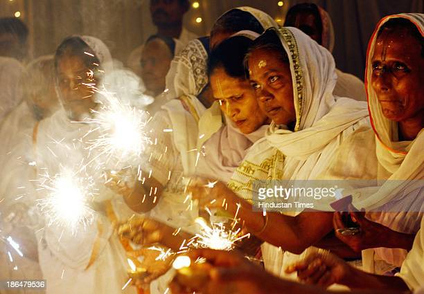 Defying traditions widows of Vrindavan celebrate Diwali at their ashram at Vrindavan on October 31 2013 in Mathura India These aged widows have been...