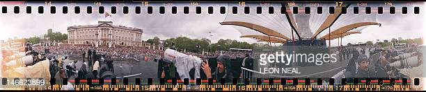 A 360 degree panoramic photograph taken using a rotating 35mm film camera shows photographers and spectators crowding around the gates of Buckingham...