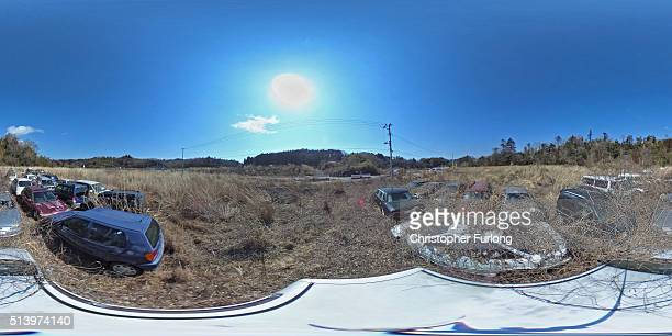 A 360 degree view of a car park inside the exclusion zone where vegetation has overtaken the cars in the five years since the Fukishima nuclear...