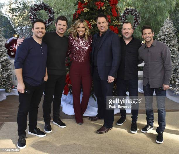 98 Degrees' Drew Lachey Nick Lachey Debbie Matenopoulos Mark Steines Justin Jeffre and Jeff Timmons visit Hallmark's 'Home Family at Universal...