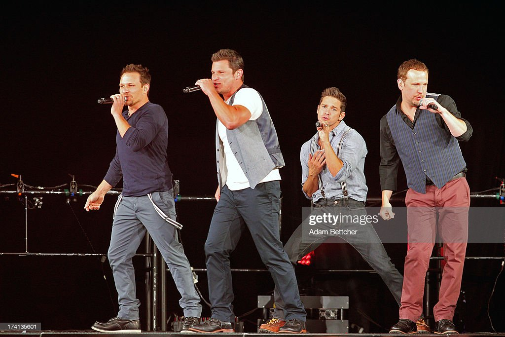 98 Degrees Drew Lachey, Nick Lachey, Justin Jeffre and Jeff Timmons perform during 'The Package Tour' with Boyz II Men and New Kids On The Block at Target Center on July 20, 2013 in Minneapolis, Minnesota.