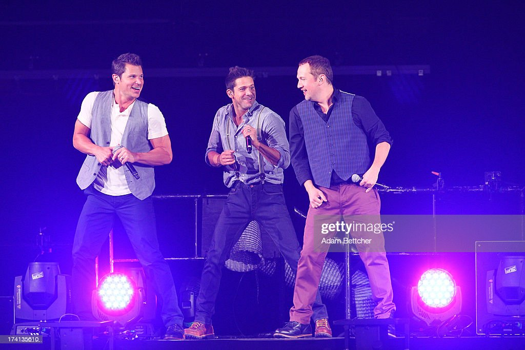 98 Degrees <a gi-track='captionPersonalityLinkClicked' href=/galleries/search?phrase=Nick+Lachey&family=editorial&specificpeople=201832 ng-click='$event.stopPropagation()'>Nick Lachey</a>, <a gi-track='captionPersonalityLinkClicked' href=/galleries/search?phrase=Justin+Jeffre&family=editorial&specificpeople=994982 ng-click='$event.stopPropagation()'>Justin Jeffre</a> and <a gi-track='captionPersonalityLinkClicked' href=/galleries/search?phrase=Jeff+Timmons&family=editorial&specificpeople=994981 ng-click='$event.stopPropagation()'>Jeff Timmons</a> perform during 'The Package Tour' with Boyz II Men and New Kids On The Block at Target Center on July 20, 2013 in Minneapolis, Minnesota.