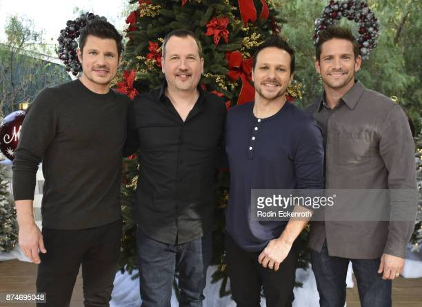 98 Degrees' Nick Lachey Justin Jeffre Drew Lachey and Jeff Timmons visit Hallmark's 'Home Family at Universal Studios Hollywood on November 15 2017...