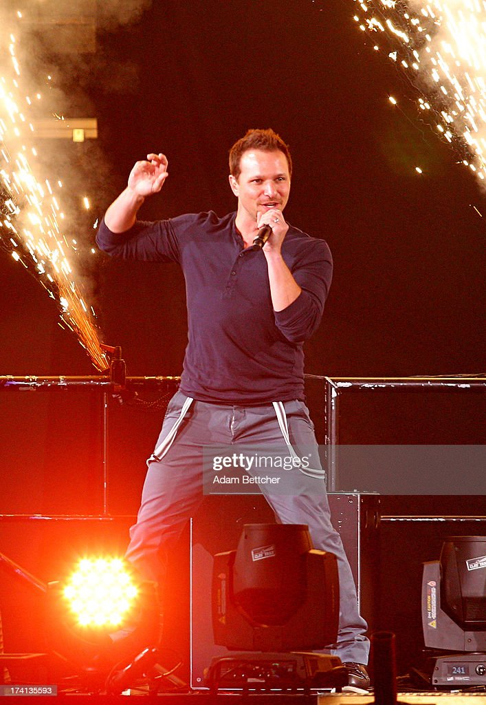 98 Degrees singer Drew Lachey performs during 'The Package Tour' at Target Center on July 20, 2013 in Minneapolis, Minnesota.