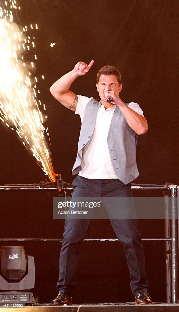 98 Degrees singer Nick Lachey performs during 'The Package Tour' at Target Center on July 20, 2013 in Minneapolis, Minnesota.