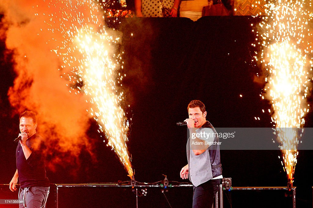 98 Degrees singer <a gi-track='captionPersonalityLinkClicked' href=/galleries/search?phrase=Nick+Lachey&family=editorial&specificpeople=201832 ng-click='$event.stopPropagation()'>Nick Lachey</a> performs during 'The Package Tour' at Target Center on July 20, 2013 in Minneapolis, Minnesota.