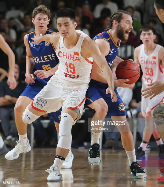 Dehao Yu of China and Isaih Tueta of the Bullets during the match between the Brisbane Bullets and China at the Gold Coast Sports Leisure Centre on...