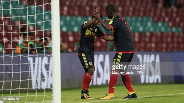 Deiber Caicedo of Colombia celebrates his goal with Gustavo Carvajal during the FIFA U17 World Cup India 2017 group B match between USA and Colombia...
