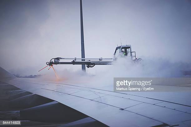 De-Icing Of Airplane Against Cloudy Sky