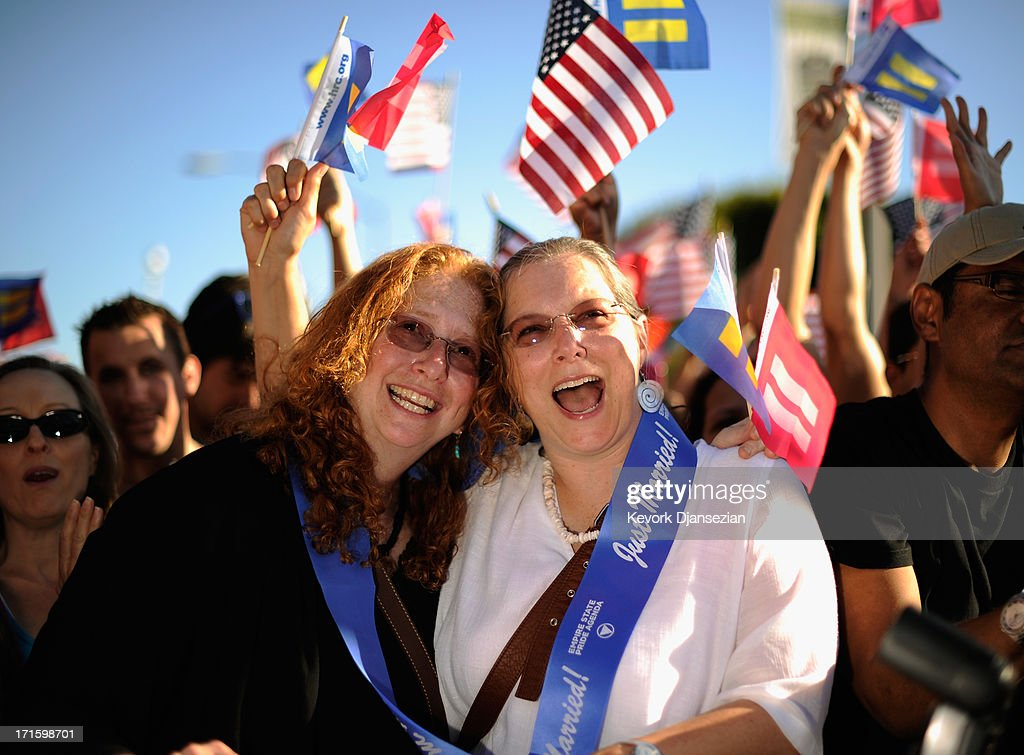 Deidre Weaver (L) and her partner Nancy Grass celebrate the US Supreme Court ruling during a community rally on June 26, 2013 in West Hollywood, California. The Supreme Court struck down the Defense of Marriage Act (DOMA) and ruled that supporters of California's ban on gay marriage, Proposition 8, could not defend it before the Supreme Court.