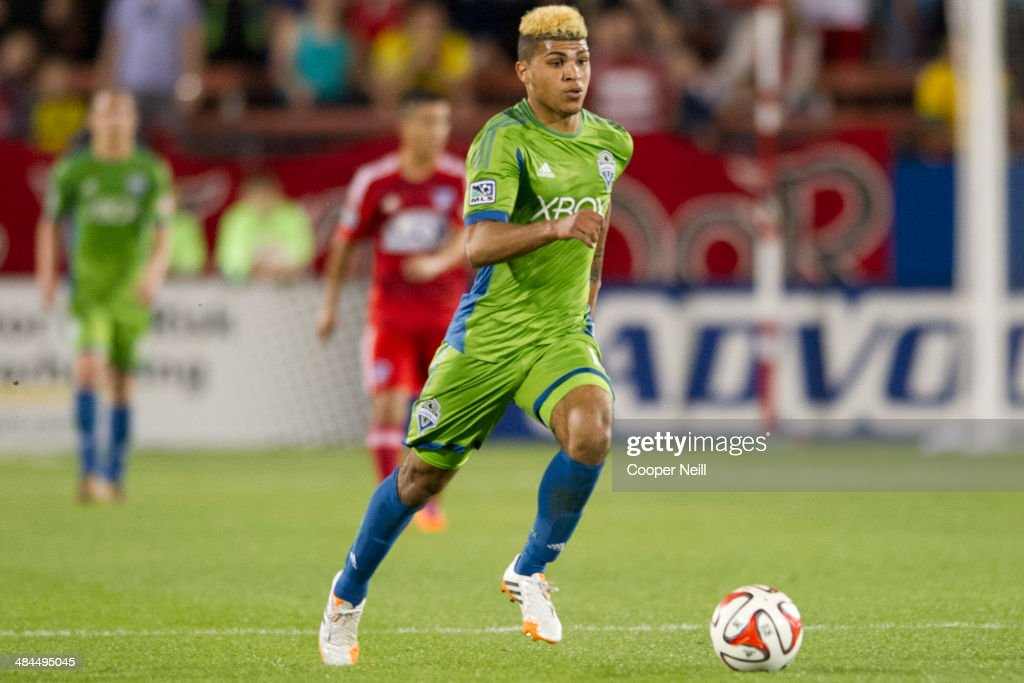 Deindre Yedlin #17 of the Seattle Sounders FC brings the ball up field against the FC Dallas on April 12, 2014 at Toyota Stadium in Frisco, Texas.