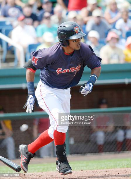 Deiner Lopez of the Portland Sea Dogs runs out a bunt for a base hit against the Altoona Curve Thursday August 17 2017