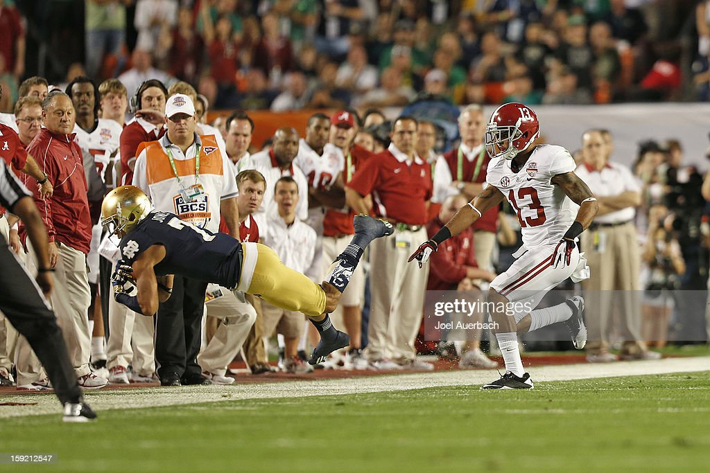 Deion Belue #13 of the Alabama Crimson Tide pursues TJ Jones #7 of the Notre Dame Fighting Irish during the 2013 Discover BCS National Championship Game at Sun Life Stadium on January 7, 2013 in Miami Gardens, Florida. Alabama defeated Notre Dame 42-14.
