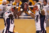 Deion Branch and Rob Gronkowski of the New England Patriots celebrate after scoring a touchdown during the game against the Pittsburgh Steelers on...
