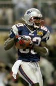 Deion Branch catches a pass from quarterback Tom Brady for the first touchdown of the game in the second quarter against the Carolina Panthers during...