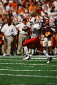 Deion Branch of the Louisville Cardinals runs with the ball against the Illinois Fighting Illini on September 22 2001