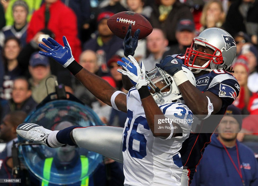 <a gi-track='captionPersonalityLinkClicked' href=/galleries/search?phrase=Deion+Branch&family=editorial&specificpeople=206261 ng-click='$event.stopPropagation()'>Deion Branch</a> #84 of the New England Patriots battles for a pass against the defense of Chris Rucker #36 of the Indianapolis Colts in the first half at Gillette Stadium on December 4, 2011 in Foxboro, Massachusetts.