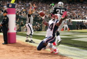 Deion Branch of the New England Patriots celebrates after scoring a touchdown against the Oakland Raiders at Oco Coliseum on October 2 2011 in...