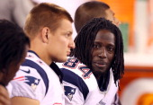 Deion Branch of the New England Patriots looks on against the New York Giants at MetLife Stadium on August 29 2012 in East Rutherford New Jersey The...