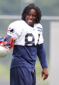 Deion Branch of the New England Patriots reacts during training camp at Gillette Stadium on July 29 2011 in Foxborough Massachusetts