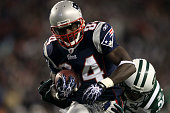 Deion Branch of the New England Patriots scores on a 25yard touchdown reception in the first quarter against the New York Jets at Gillette Stadium on...