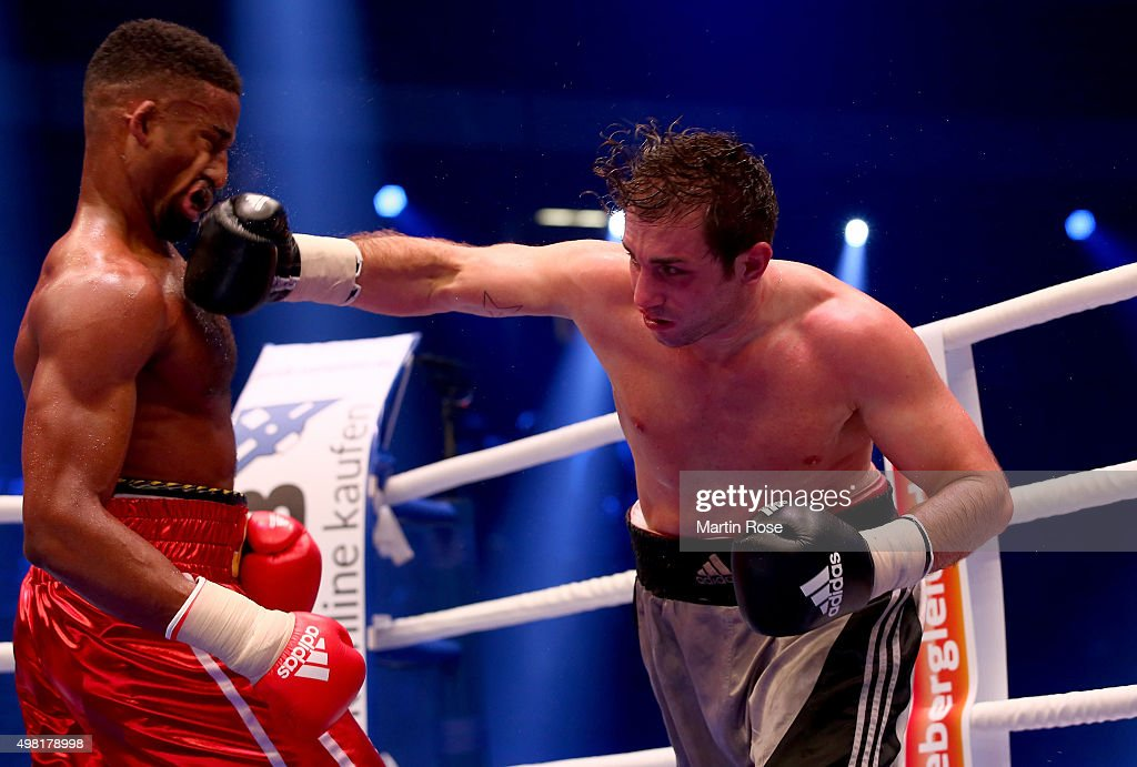 Deion Jumah of Great Britain exchange punches with Fabrizio Leone of Italy during their light heavy weight fight at TUI Arena on November 21 2015 in...