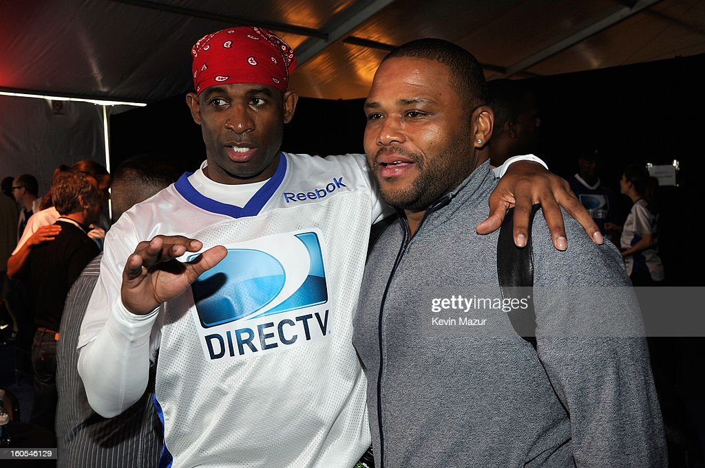 Deion Sanders and actor Anthony Anderson attend DIRECTV'S 7th annual celebrity Beach Bowl at DTV SuperFan Stadium at Mardi Gras World on February 2, 2013 in New Orleans, Louisiana.