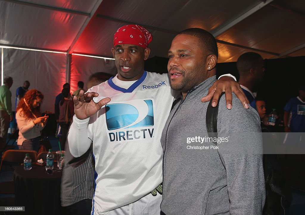 Deion Sanders (L) and Anthony Anderson attend DIRECTV'S Seventh Annual Celebrity Beach Bowl at DTV SuperFan Stadium at Mardi Gras World on February 2, 2013 in New Orleans, Louisiana.