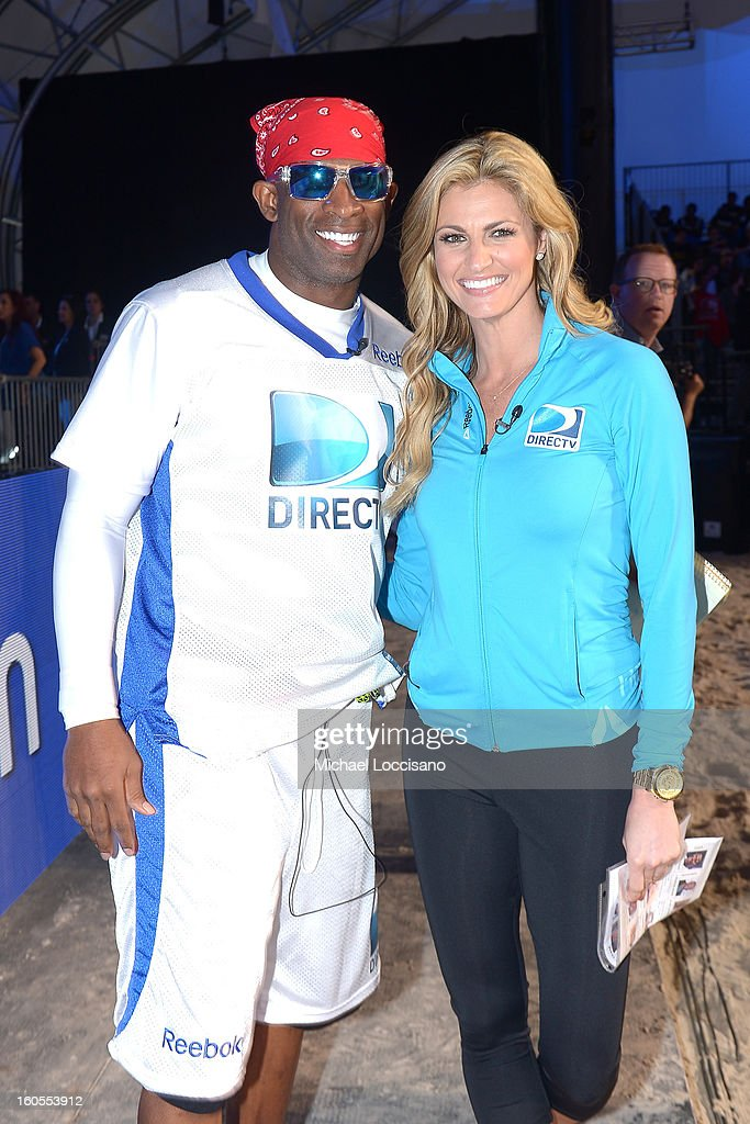 Deion Sanders and Erin Andrews attend DIRECTV'S Seventh Annual Celebrity Beach Bowl at DTV SuperFan Stadium at Mardi Gras World on February 2, 2013 in New Orleans, Louisiana.
