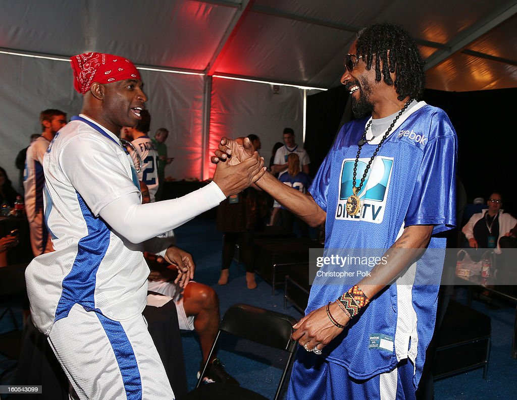 Deion Sanders (L) and Snoop Lion attend DIRECTV'S Seventh Annual Celebrity Beach Bowl at DTV SuperFan Stadium at Mardi Gras World on February 2, 2013 in New Orleans, Louisiana.