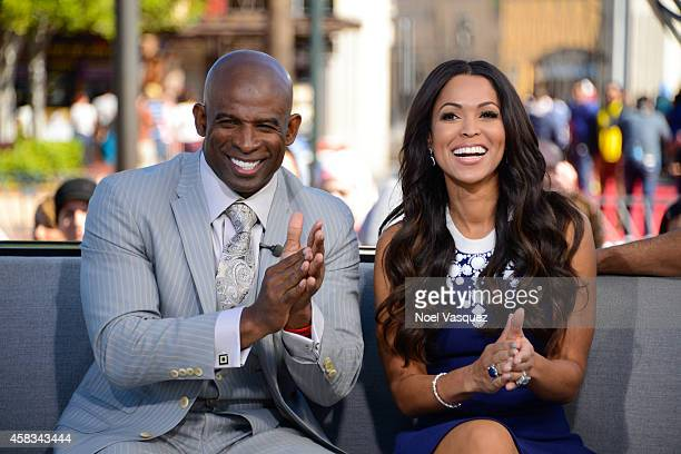 Deion Sanders and Tracey Edmonds visit 'Extra' at Universal Studios Hollywood on November 3 2014 in Universal City California