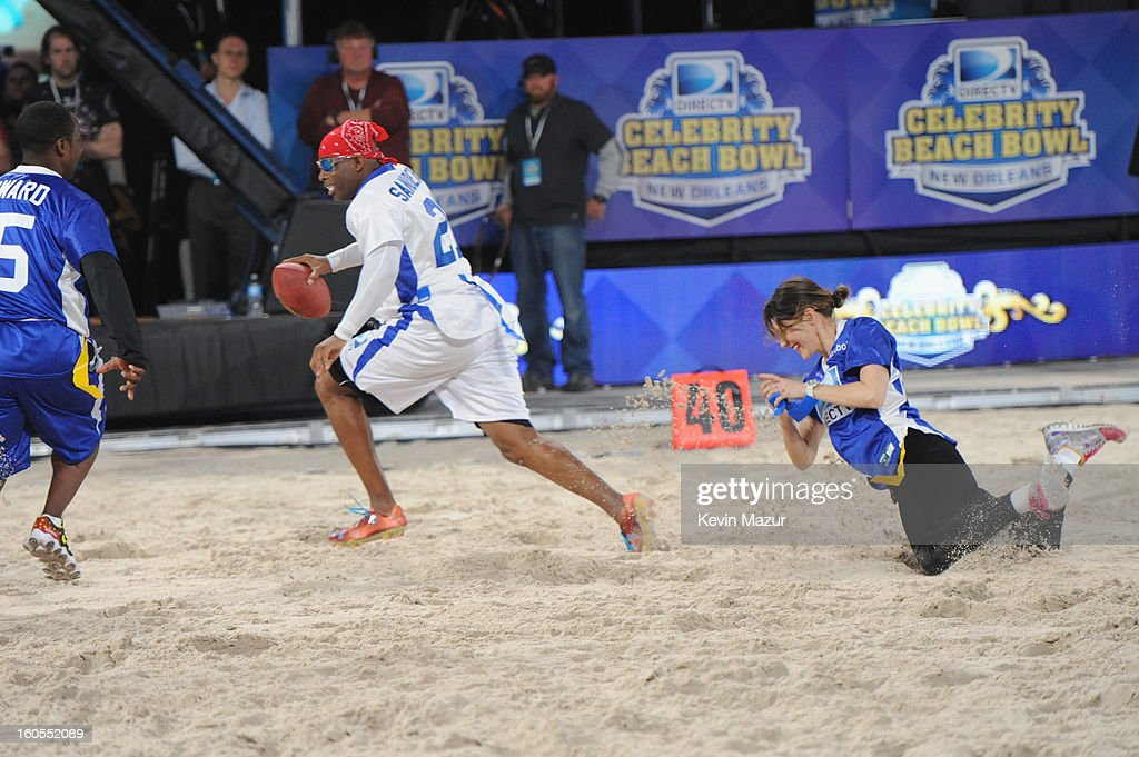 Deion Sanders (C) attends DIRECTV'S 7th annual celebrity Beach Bowl at DTV SuperFan Stadium at Mardi Gras World on February 2, 2013 in New Orleans, Louisiana.