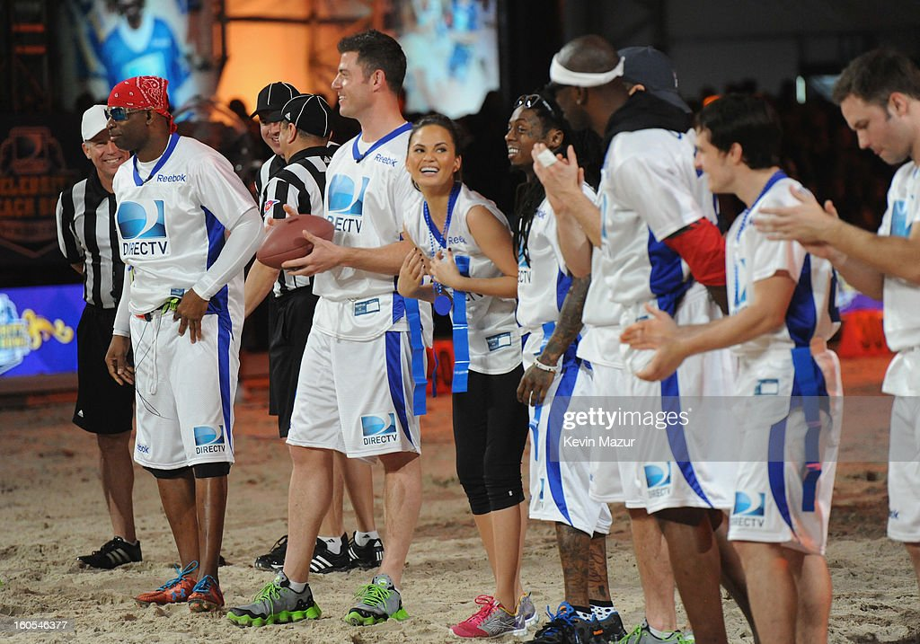 Deion Sanders, Jesse Palmer, Chrissy Teigen, Lil Wayne, Terrell Owens, and Josh Hutcherson attend DIRECTV'S 7th annual celebrity Beach Bowl at DTV SuperFan Stadium at Mardi Gras World on February 2, 2013 in New Orleans, Louisiana.