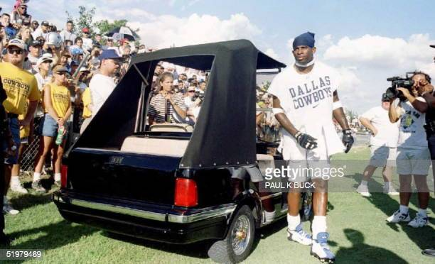 Deion Sanders of the Dallas Cowboys arrives for summer training camp in his custommade MercedesBenz golf cart 21 July at St Edwards University in...