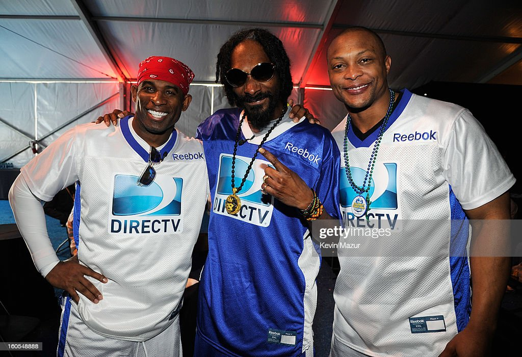 Deion Sanders, Snoop Lion, and Eddie George attend DIRECTV'S 7th annual celebrity Beach Bowl at DTV SuperFan Stadium at Mardi Gras World on February 2, 2013 in New Orleans, Louisiana.