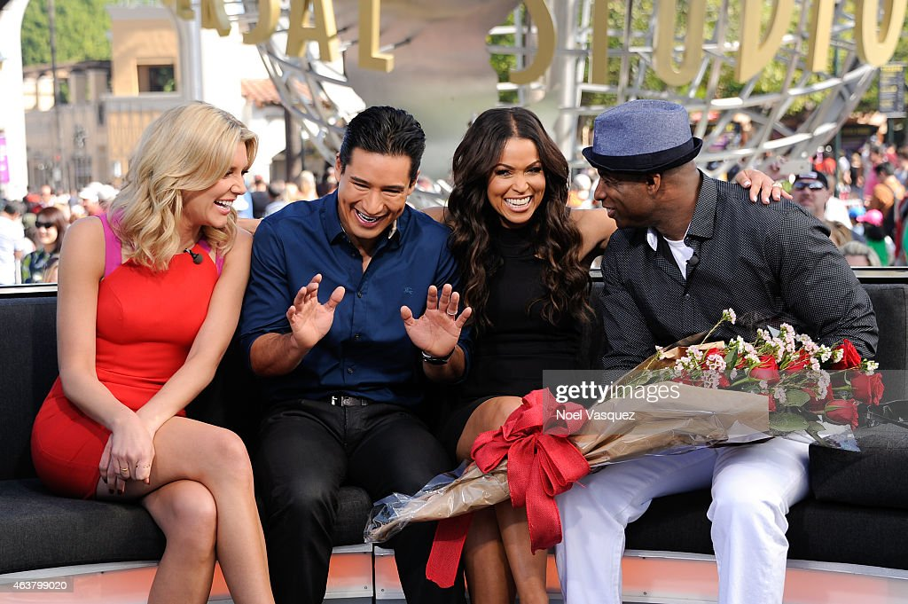 Deion Sanders (R) surprises Tracey Edmonds (2R) on her birthday with ...