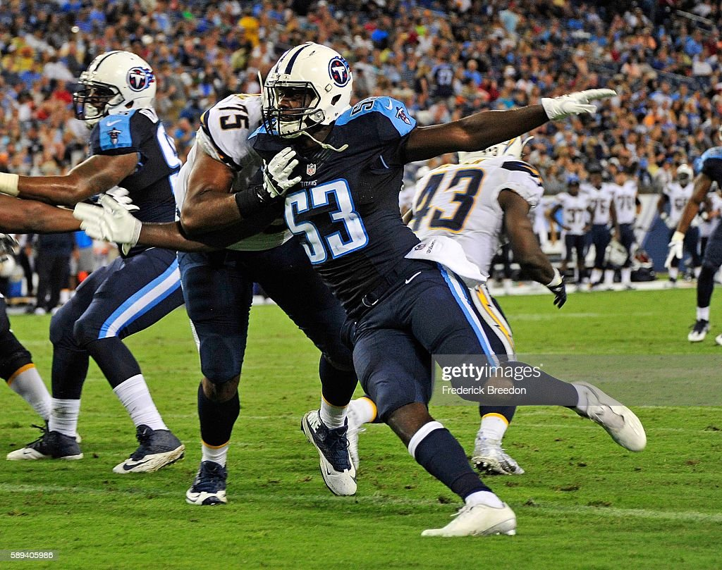 Deiontrez Mount #53 of the Tennessee Titans rushes against Chris Hairston #75 during the first half at Nissan Stadium on August 13, 2016 in Nashville, Tennessee.