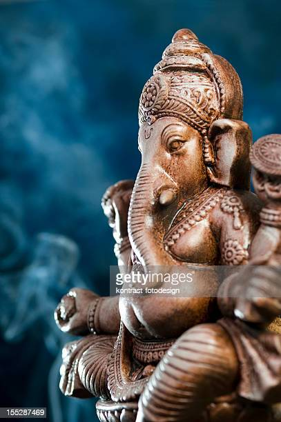Deity of Ganesha from India on blue background