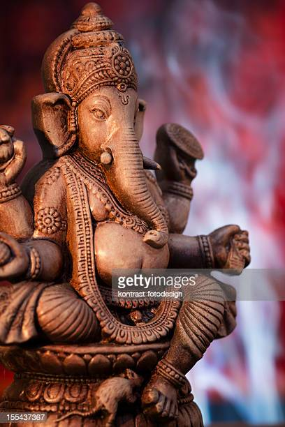 Deity of Ganesha from India on red background