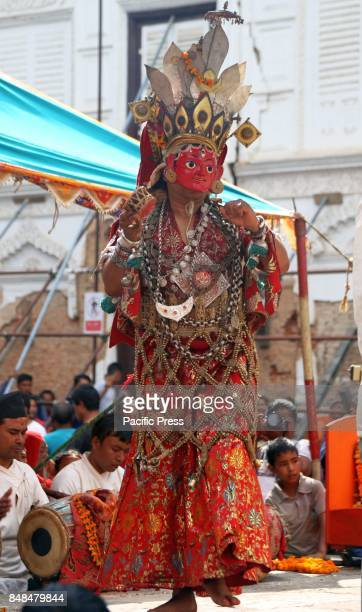 A deity performs religious dance during the 12 years Swetkali festival of Naradevi The festival usually occurs once in 12 years by taking out parade...