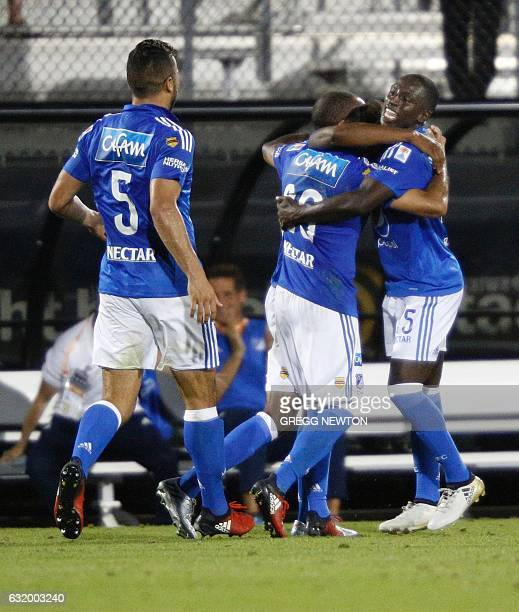 Deiver Machado and Andres Cardona of Colombian side Millonarios FC celebrate with Juan Guillermo Domingues after he scored the gamewinning goal on a...
