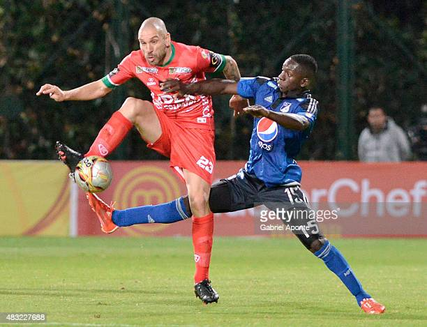 Deiver Machado of Millonarios struggles for the ball with Jorge Ramirez of Patriotas FC during a match between Patriotas FC and Millonarios as part...
