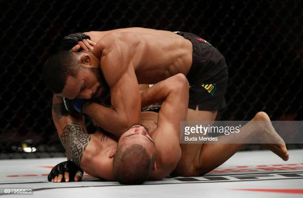 Deiveson Figueiredo of Brazil elbows Marco Beltran of Mexico in their flyweight bout during the UFC 212 event at Jeunesse Arena on June 3 2017 in Rio...