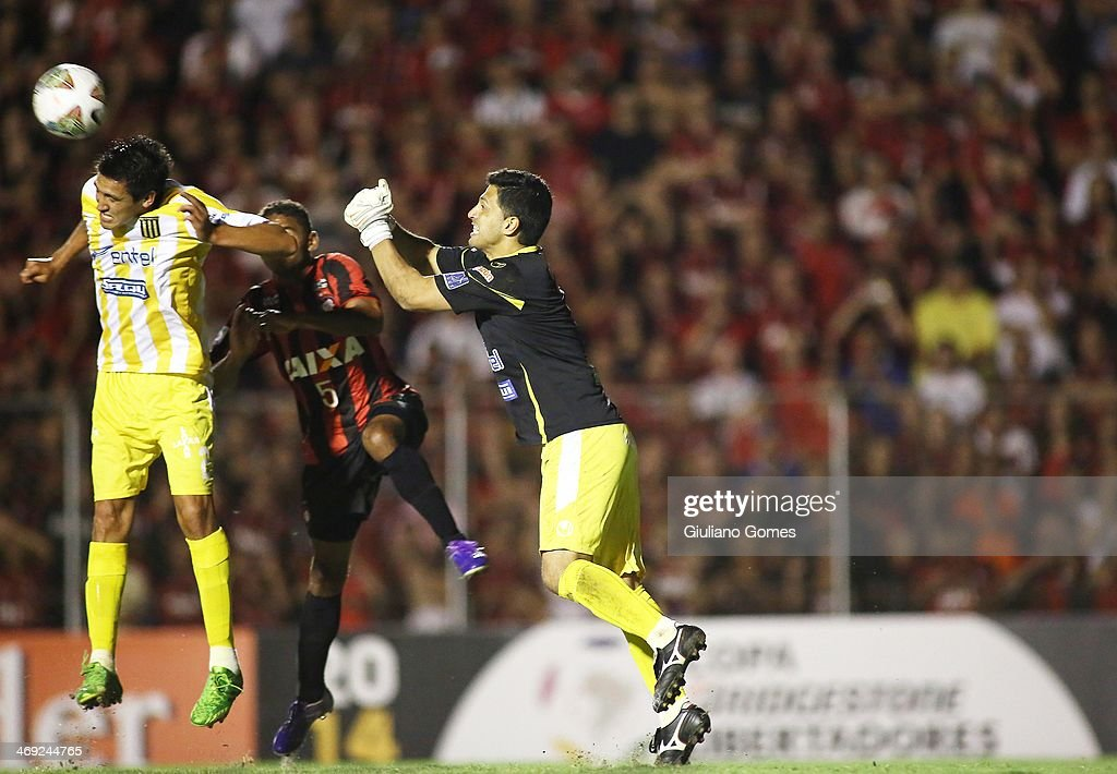 Deivid of Atletico Paranaense battles for the ball against Marcos Barrera, Jemio of The Strongest during a match between Atletico Paranaense and The Strongest as part of Copa Bridgestone Libertadores 2014 at Durival Britto Stadium on February 13, 2014 in Curitiba, Parana, Brazil.