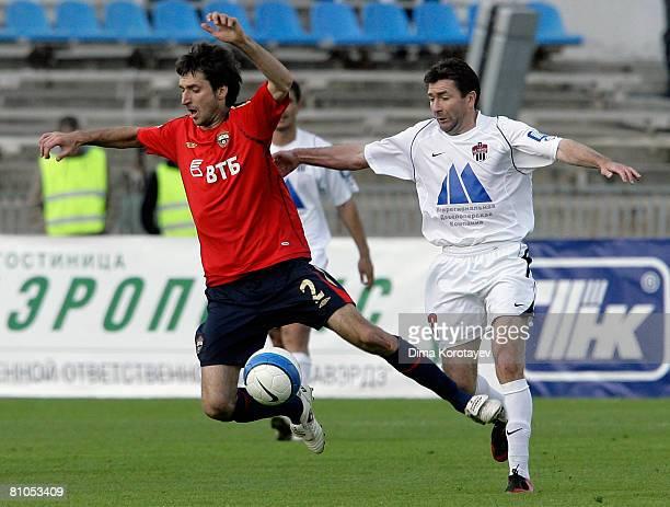 Deividas Semberas of PFC CSKA Moscow battles for the ball with Yuri Drozdov of FC Khimki during the Russian Football League Championship match...