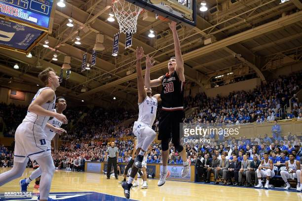 Deivydas Kuzavas of the St Francis Red Flash puts up a shot against Trevon Duval of the Duke Blue Devils at Cameron Indoor Stadium on December 5 2017...